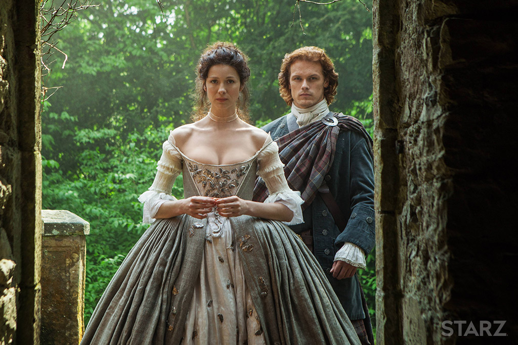 "Jamie Fraser (Sam Heughans) and Claire (Caitríona Balfe) in ""The Wedding,"" Outlander s1 e7 (2014)"